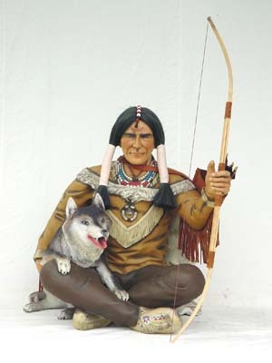 This is a very charming life-size seated figure of a North American ...